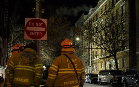 Firefighters put out a major house fire on Prospect Avenue on December 29, 2017 in the Bronx borough of New York City. Over 170 firefighters respond to the evening fire in which at least 12 persons were killed with others injured. Picture: AFP.