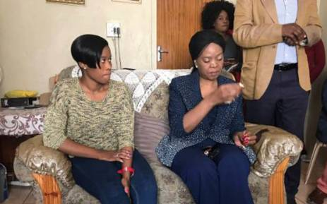 Social Development MEC Nandi Mayathula-Khoza at 2-year-old Bohlale Mokoena's home in Sharpeville. Next to the MEC is the child's mother, Mpho. Picture: Masego Rahlaga/EWN