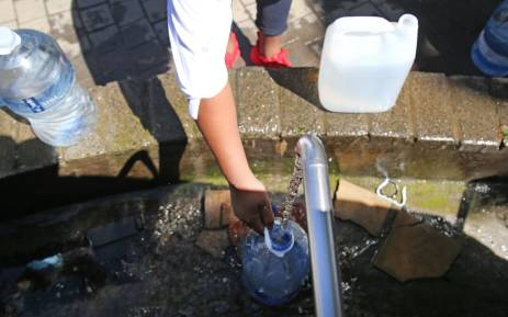 A Cape Town resident fills up a 5 litre bottle as Capetonians prepare for Day Zero, the day the taps run dry. Picture: Bertram Malgas/EWN