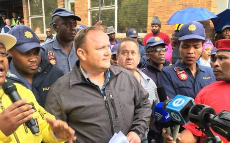 Chief operating officer at the Optimum Mine receives a memorandum of demands from workers at the mine on 22 February 2018. Picture: Pelane Phakgadi/EWN