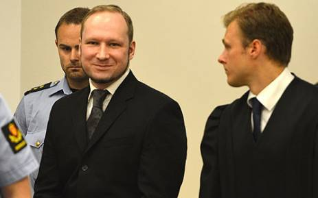 Mass murderer Anders Behring Breivik (L) arrives in court at Oslo central court on 24 August 2012 to be sentenced for his twin attacks that left 77 people dead. Picture: AFP