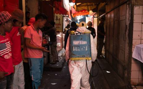 A council worker sprays disinfectant during the clean-up of the market of Anosibe in the Anosibe district of Antananarivo in Madagascar on 10 October 2017. Picture: AFP