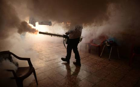 A Health Ministry employee fumigates a home against the Aedes aegypti mosquito to prevent the spread of the Zika virus. Picture: AFP