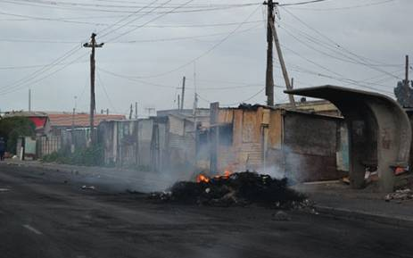 A pile of rubble burns on Lansdowne Road in Khayelitsha after service delivery protests the previous evening on 14 August 2012. Picture: Aletta Gardner/EWN
