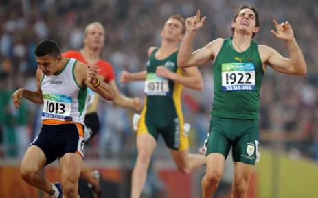 Fanie van der Merwe (R) of South Africa celebrates next to second place Sofiane Hamdi (L) of Algeria after winning the final of the men's 200 metre T37 classification event at the 2008 Beijing Paralympic Games. Picture: AFP.