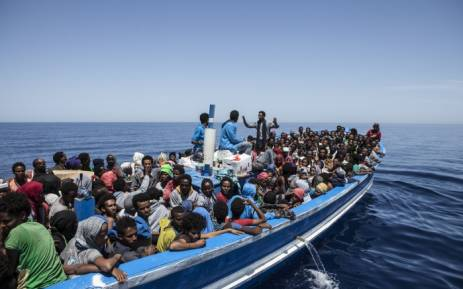 FILE: Migrants seen aboard a wooden boat on the Mediterranean sea. Picture: AFP/MOAS.
