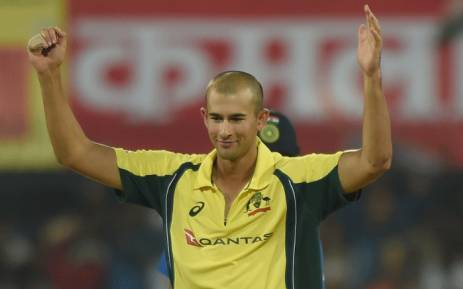 Australian cricketer Ashton Agar celebrates after taking the wicket of Indian captain Virat Kohli during the third one-day international cricket match at the Holkar Stadium in Indore on 24 September 2017. Picture: AFP.