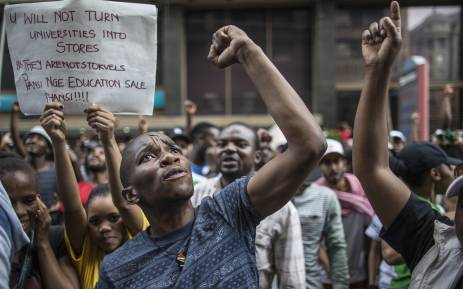 Students shout slogans outside the African National Congress ruling party (ANC) headquarters, on October 22 2015, in Johannesburg during a demonstration against university fee hikes. Picture: AFP.