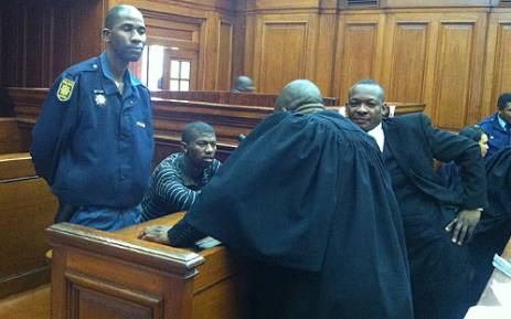 Xolile Mngeni, the man alleged to have shot Anni Dewani, speaks with his lawyers on 30 august 2012. Picture: Nathan Adams/EWN