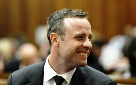 Oscar Pistorius smiles during the first day of his trial in the North Gauteng High Court on 3 March 2014. Picture: POOL.