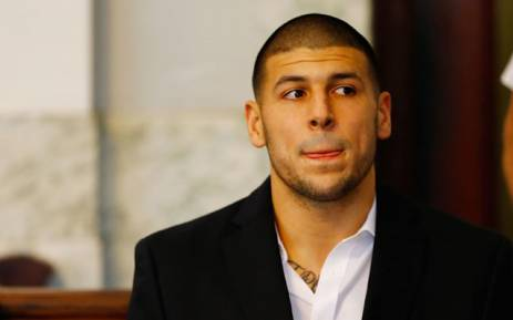 This file photo taken on 21 August 2013 shows Aaron Hernandez sitting in the courtroom of the Attleboro District Court during his hearing in North Attleboro, Massachusetts.  Prison officials said the former American football star Aaron Hernandez on 19 April 2017 was found dead in prison where he was serving a life sentence for murder after hanging himself with a bedsheet. Picture: AFP.