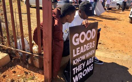 Students hold a placard outside the Randburg magistrates court, where former deputy Higher Education Minister Mduduzi Manana is appearing on assault charges. Picture: Katleho Sekhotho/EWN
