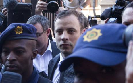 FILE: Oscar Pistorius arriving under heavy police guard at the High Court in Pretoria ahead of judgment in his murder trial on 12 September 2014. Picture: Christa Eybers/EWN.