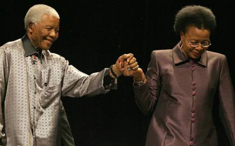 Former president Nelson Mandela is helped by his wife Graca Machel in a picture taken in 2007. Picture:Werner Beukes/SAP