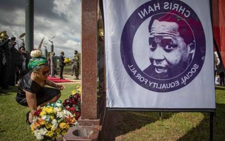 Chris Hani's daughter Lindiwe Hani places flowers on her father's grave at the Thomas Titus Nkobi Memorial Park. Picture: Thomas Holder/EWN