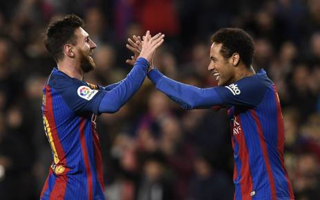 Barcelona's Lionel Messi (L) celebrates a goal with teammate Neymar. Picture: AFP