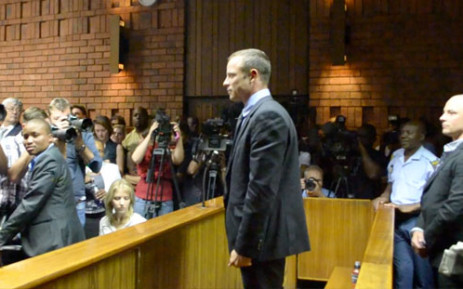Oscar Pistorius stands in the dock as he waits to hear the outcome of his bail application. Picture: Lesego Ngobeni/EWN.