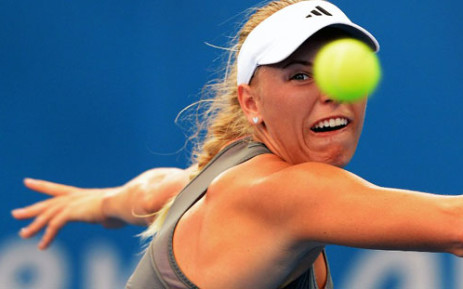 Caroline Wozniacki of Denmark keeps her eye on the ball in her match against Ksenia Pervak of Kazakhstan in the first round at the Brisbane International tennis tournament on 31 December, 2012. Picture: AFP
