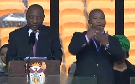 A screenshot of ANC deputy president Cyril Ramaphosa leading proceedings at the FNB Stadium, with the controversial sign language interpreter next to him.