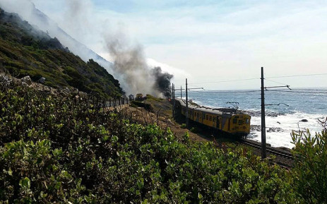 A Metrorail train in Fish Hoek caught alight on Thursday 21 January 2015. Picture: Russel Human.