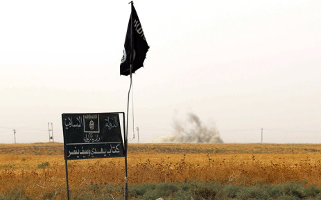 An Islamic State group (IS) flag and banner in Iraq. Picture: AFP