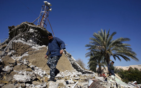 An Iraqi policeman inspects the debris at the Sunni Al-Fateh mosque, that was one of two mosques bombed overnight, in a village called Sinjar, just outside Hilla, about 80 kilometres south the capital Baghdad on January 4, 2016.  Picture: AFP/Haidar Hamdani.