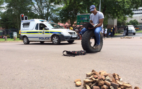 Demonstrating students and the police have clashed at the University of Pretoria's main entrance, where several students have also been arrested on 19 February 2016. Picture: Barry Bateman/EWN.
