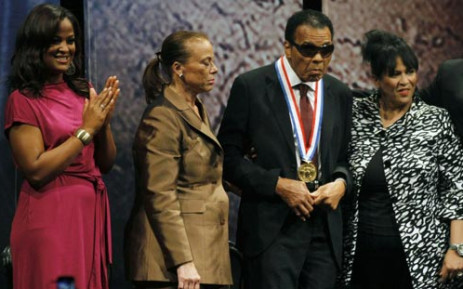 Former boxing champion Muhammad Ali (2nd R) poses along with his family, daughter Laila Ali (L), wife Lonnie Ali (2nd L) and sister-in-law Marilyn Williams (R) after being presented with the 2012 Liberty Medal on September 13, 2012. Picture: AFP.