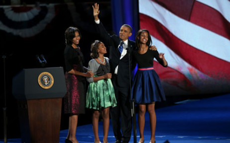 US President Barack Obama walks on stage with first lady Michelle Obama and daughters Sasha and Malia to deliver his victory speech on election night at McCormick Place November 6, 2012 in Chicago, Illinois. Picture: AFP