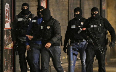Members of French police special forces in the northern Paris suburb of Saint-Denis city center, on 18 November, 2015, as French Police special forces raid an appartment, hunting those behind the attacks that claimed 129 lives in the French capital five days ago. At least one person was killed in an apartment targeted in the operation aimed at the suspected mastermind of the attacks, Belgian Abdelhamid Abaaoud, and police had been wounded in the shootout. Picture: AFP.