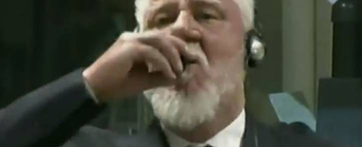 A screengrab purporting to show wartime commander of Bosnian Croat forces Slobodan Praljak drinking what he said was poison in court.