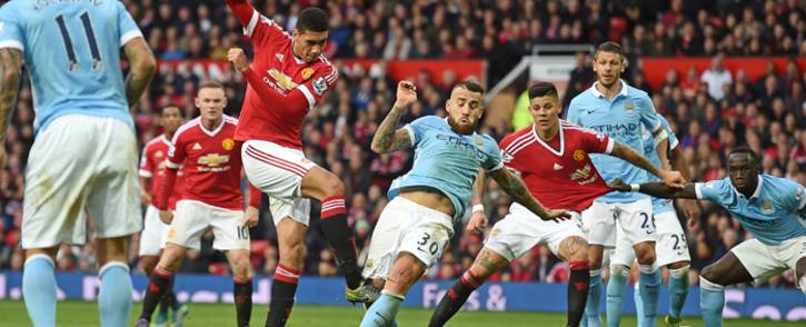 Manchester United's English defender Chris Smalling (4th L) takes an unsuccessful shot on goal during the English Premier League football match between Manchester United and Manchester City at Old Trafford in Manchester, north west England, on October 25, 2015. Picture: AFP.
