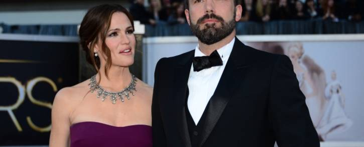 FILE: Actor and director Ben Affleck and wife actress Jennifer Garner arrive on the red carpet for the 85th Annual Academy Awards in February 2013 in Hollywood, California. Picture: AFP.