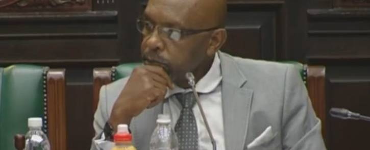 A screengrab of committee chairperson Vincent Smith listening to deliberations in Parliament.