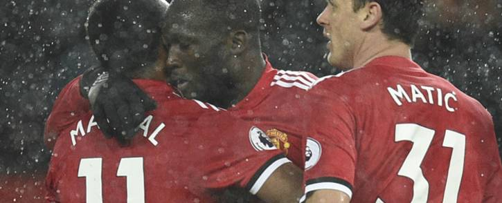 Manchester United's Belgian striker Romelu Lukaku embraces Manchester United's French striker Anthony Martial as he celebrates scoring their third goal during the English Premier League football match between Manchester United and Stoke City at Old Trafford in Manchester, north west England, on 15 January, 2018. Picture: AFP.