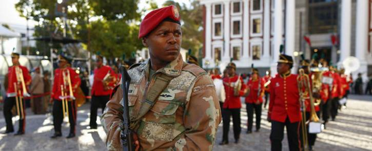 An SANDF soldier patrols in the streets near the Parliament ahead of the arrival of South Africa's President for the opening ceremony of the State Of The Nation Address (SONA) in Cape Town, on February 9, 2017. Picture: AFP