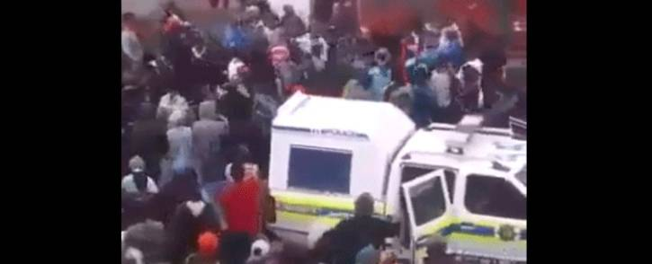 A screengrab shows some Hanover Park community members as they surround a police vehicle after officers were deployed to the area on 19 September 2017. Picture: facebook.com