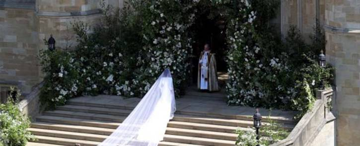 US actress Meghan Markle arrives for the wedding ceremony to marry Britain's Prince Harry, Duke of Sussex, at St George's Chapel, Windsor Castle, in Windsor, on 19 May 2018. Flowers and foliage surround the West Door and steps of St George's Chapel at Windsor Castle. Picture: AFP.
