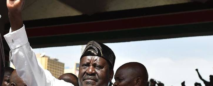 """Kenya's opposition National Super Alliance (NASA) coalition leader Raila Odinga gestures after swearing-in himself as the """"people's president"""" on 30 January 2018 in Nairobi. Picture: AFP"""