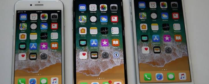 FILE: (L-R) The new iPhone 8, iPhone X and iPhone 8S are displayed during an Apple special event at the Steve Jobs Theatre on the Apple Park campus on September 12, 2017 in Cupertino, California. Picture: AFP