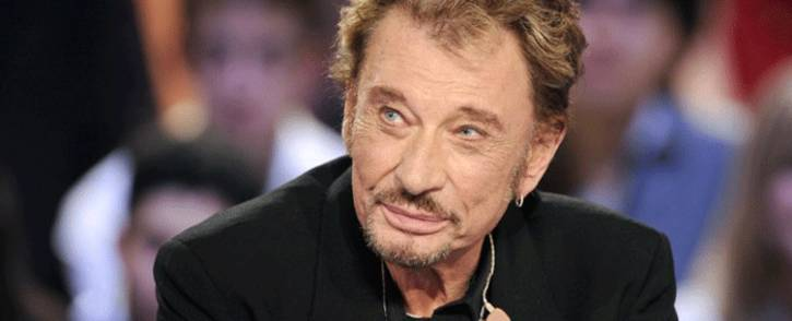"""FILES: In this file photo taken on March 28, 2011 French singer Johnny Hallyday attending a TV broadcast show """"Le Grand Journal"""" on Canal + TV channel in Paris. Picture: AFP."""