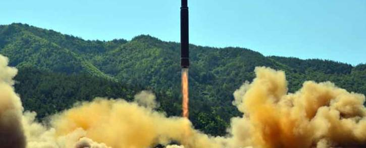 This picture taken on 4 July 2017 and released by North Korea's official Korean Central News Agency on 5 July 2017 shows the successful test-fire of the intercontinental ballistic missile Hwasong-14 at an undisclosed location. Picture: AFP.