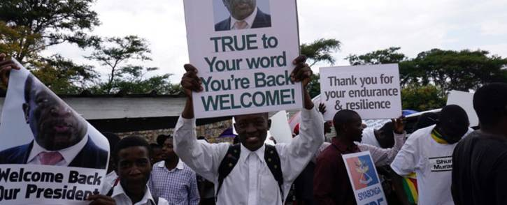 People gather outside Harare's airport to welcome former Zimbabwean vice-president Emmerson Mnangagwa on November 22, 2017 in Harare. Picture: AFP