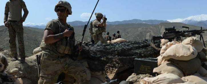 In this photograph taken on 11 April 2017, US soldiers take up positions during an ongoing an operation against Islamic State militants in the Achin district of Afghanistan's Nangarhar province. Picture: AFP.