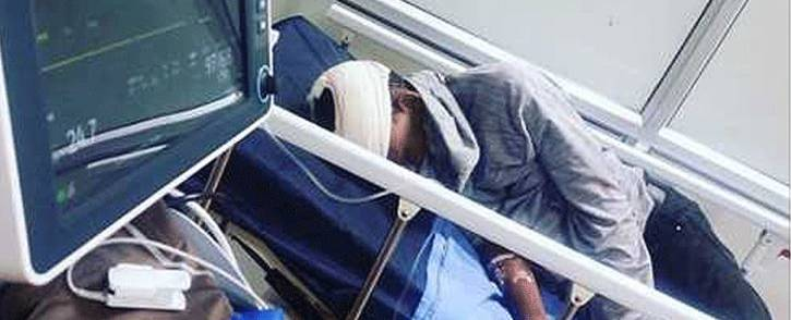 Thabang Mosiako pictured in hospital following an attack. Picture: facebook.com