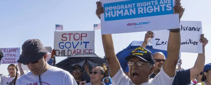 """Activists shout chants during the """"End Family Detention,"""" event held at the Tornillo Port of Entry in Tornillo, Texas on 24 June 2018. Picture: AFP."""