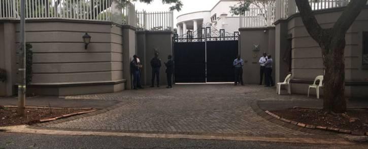 The Asset Forfeiture Unit raids the Gupta compound in Saxonwold on 16 April 2018. Picture: Pelane Pakgadi/EWN.