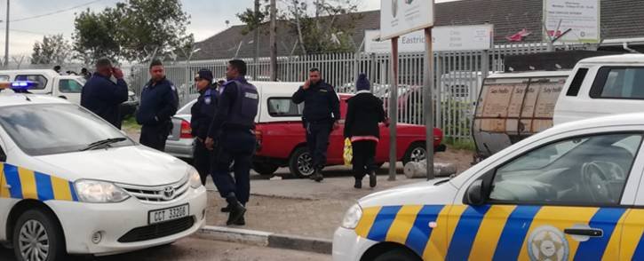 Police monitor the situation at Eastridge Clinic in Mitchells Plain, Cape Town following a shooting that left one dead. Picture: Jody Khan