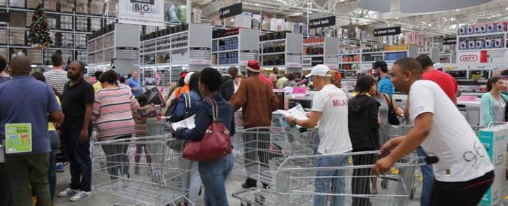 Hundreds of customers run inside the Makro store at it opens for Black Friday sale on 25  November 2016. Picture: Christa Eybers/EWN.