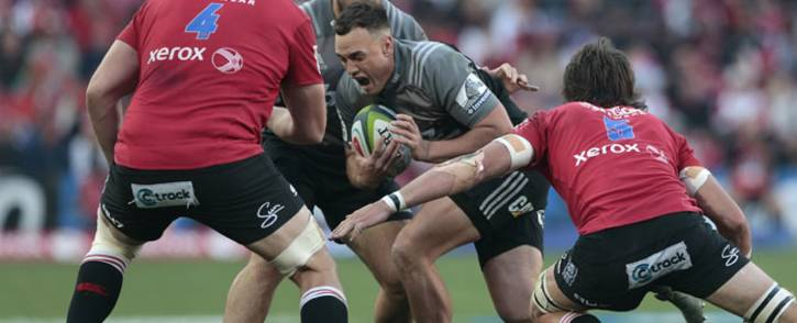 Crusaders' New Zealand Isral Dagg (C) runs with the ball during the Super XV rugby final match between Lions and Crusaders at the Ellis Park Rugby stadium on 5 August 2017 in Johannesburg. Picture: AFP